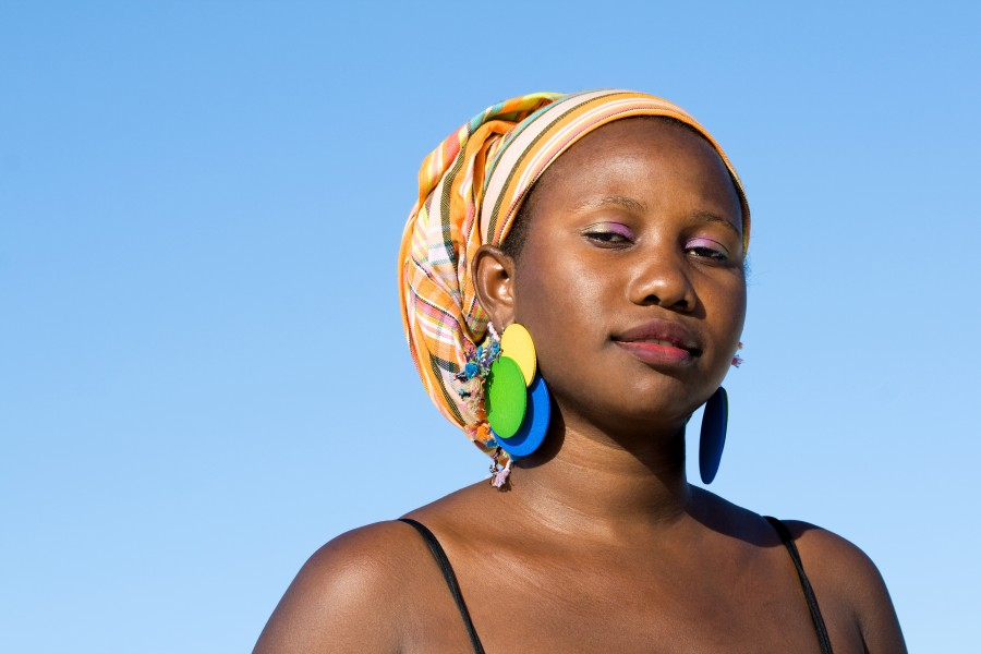 Portrait of young confident african woman with scarf